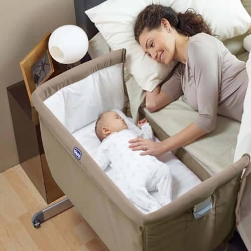 Mother and baby in a bassinet